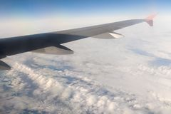 Wing of an airplane above solid clouds Stock Images