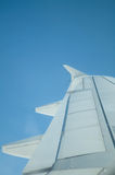 Wing of airplane against a blue sky Royalty Free Stock Photography