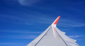 Wing of airplane with the blue sky Royalty Free Stock Photography