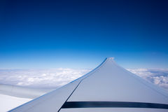 Wing of an airplane, blue sky Stock Photo
