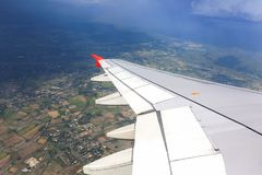 Wing of the airplane country land. travel concept. Royalty Free Stock Images