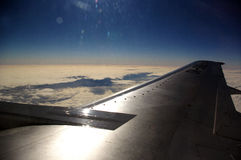 Wing of airplane in flight Royalty Free Stock Image