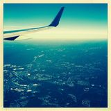 Wing of airplane in flight Stock Photo