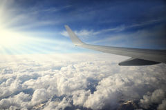 Wing of airplane fly over the blue sky and beautiful mountain landscape Stock Photography