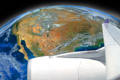 Wing of airplane fly over the earth ,including elements furnished by NAS Stock Image