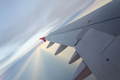 Wing of an airplane flying Royalty Free Stock Photo