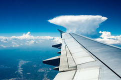 Wing of  airplane  flying above the cloud Royalty Free Stock Image