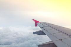 Wing of an airplane flying above Stock Photography