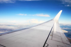 Wing of an airplane flying Stock Image