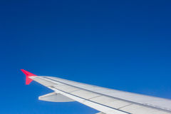 Wing airplane flying above clouds looking at the sky from the wi Stock Photography