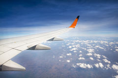 Wing of airplane flying Royalty Free Stock Photo