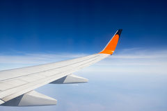 Wing of airplane flying Stock Image