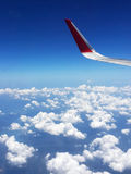 Wing of airplane flying above Royalty Free Stock Photography