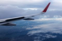 Wing of airplane in the sky. Wing of airplane flying in the clouds in the sky Stock Images
