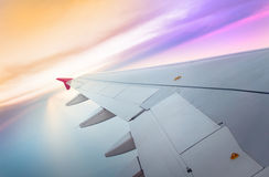 Wing of an airplane flying Stock Images