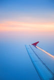 Wing of airplane flying in the sky Stock Photos