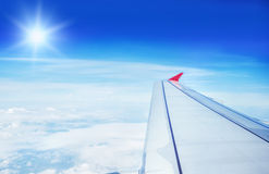 The Wing of an airplane flying in the sky Stock Photography