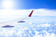 Wing of an airplane flying in the sky Royalty Free Stock Photography