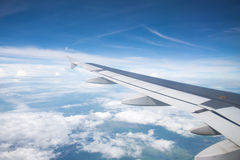 Wing of an airplane flying in the sky so Royalty Free Stock Photography