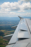 Wing of airplane going to land Stock Image