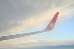 Wing of airplane Lionair in sky Stock Photo