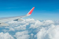 Wing of airplane over beautiful white clouds with bue sky. Wing of airplane over white clouds with bue sky stock photos