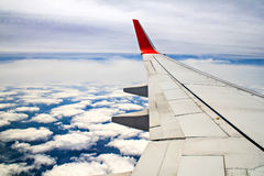 The wing of airplane over cloud Royalty Free Stock Photos