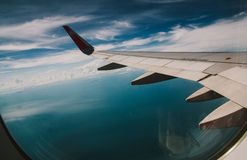 Wing of an airplane over the gulf of Thailand Stock Photography