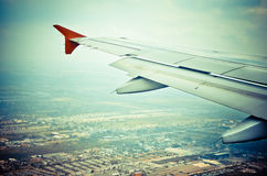 Wing of an airplane preparing to land Stock Photography