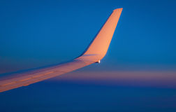 Wing of airplane. Red Wing of airplane with blue sky stock image