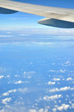 Wing of airplane and sky Royalty Free Stock Photo