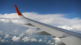 Wing of airplane on sky and cloud on moving Stock Photos