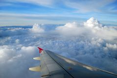 The wing of airplane in the sky Stock Photos
