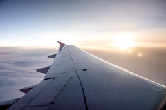 Wing of an airplane on the sky Royalty Free Stock Images