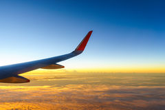Wing of airplane in the sunrise Stock Images