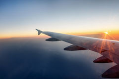 The wing of a airplane at sunset Royalty Free Stock Photo