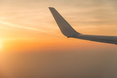Wing of airplane in the sunset Royalty Free Stock Image