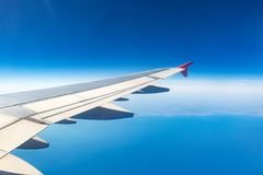 Wing of an airplane. Traveling concept. Aircraft wing on the clouds royalty free stock photo