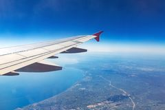 Wing of an airplane. Traveling concept. Aircraft wing on the clouds stock photography