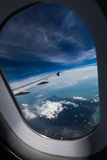 Wing of an airplane. A wing of an airplane,through the window Stock Photography