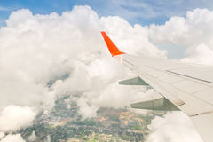 Wing of airplane from window in cloud Royalty Free Stock Image