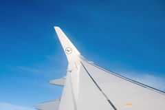 Wing of airplane from window Stock Images