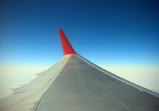 Wing of airplane from window Stock Photo