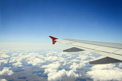 Wing of airplane from window Stock Photography