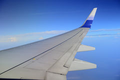 Wing of airplane from window Royalty Free Stock Photo
