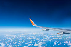 Wing of airplane from window Stock Photos