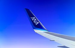 Air Travel. Theme: Airplane Wing against a Vivid Blue Sky royalty free stock image