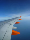 Wing on the blue endless sky Royalty Free Stock Photos