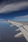 Wing in the blue sky. Flying through the Balinese sky stock photos