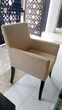 Wing chair in lobby Stock Image